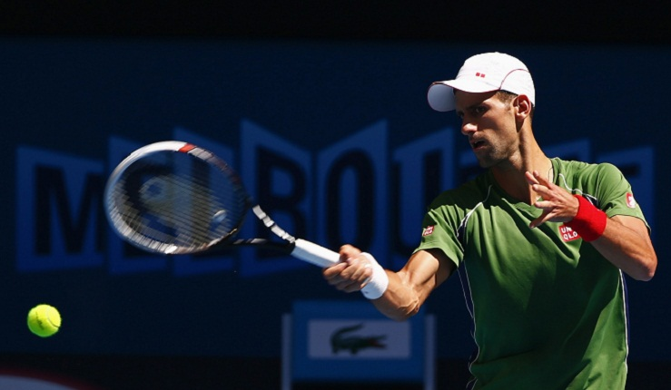 Djokovic hits a return during a practice session at the Australian Open 2014 tennis tournament in Melbourne