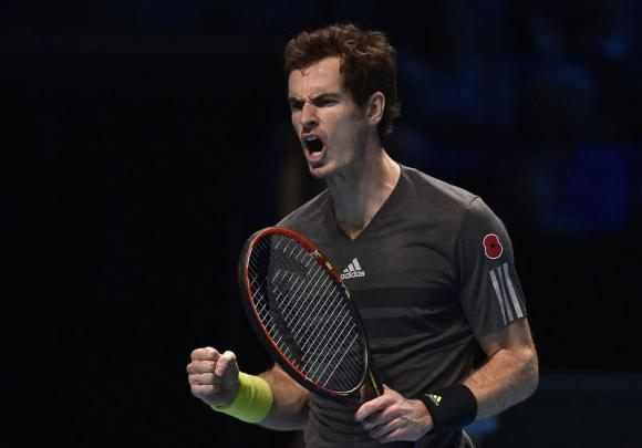 Andy Murray reacts during his tennis match against Milos Raonic at the ATP World Tour finals in London
